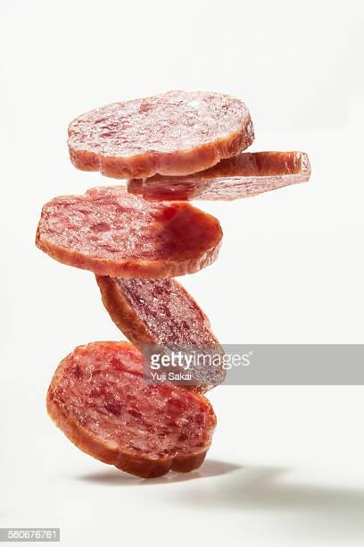 pile up sliced salami sausage