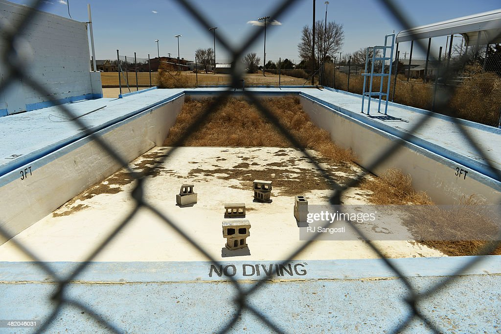 Piled 10-feet-deep tumbleweeds collect in the deep end of the Eads swimming pool that is closed for the season, Monday, March 31, 2014. Years of drought in southeast Colorado is causing Russian Thistle to
