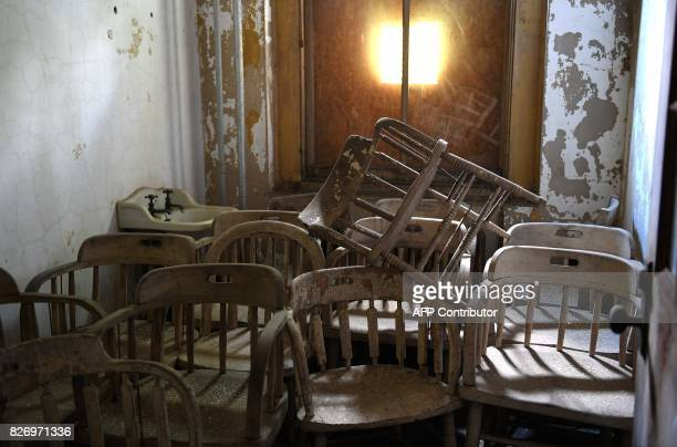 Piled chairs are seen in a room in one of the buildings of the The Ellis Island Hospital on August 5 a 750bed facility which treated over 12 million...