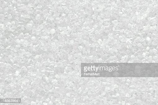 Piled up granules of white sugar shining
