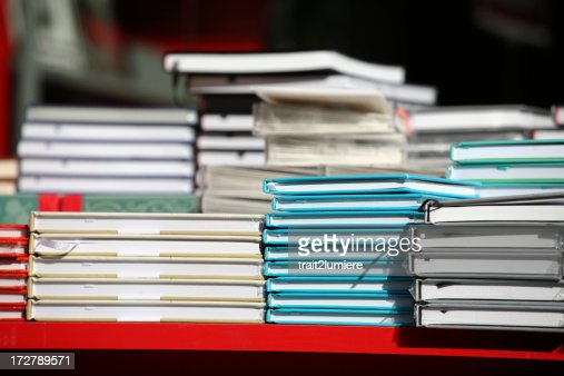Piles of books in a bookstore
