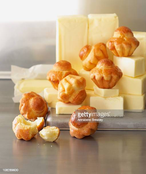 piles of brioche on piles of butter