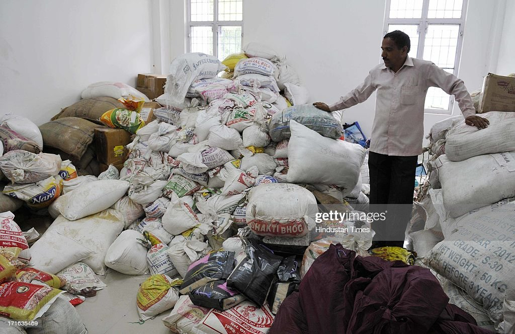 Piles of clothes and blankets to be distributed among the flash flood victims stored in the Sports College on June 27, 2013 in Dehradun, India. Air rescue operations resumed today to pull out stranded people but they had to be halted for Badrinath as the weather turned bad, even as decaying bodies were being cremated swiftly in worst-hit Kedarnath Valley amid fears of an epidemic outbreak.