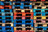 Piles of colored wooden pallets