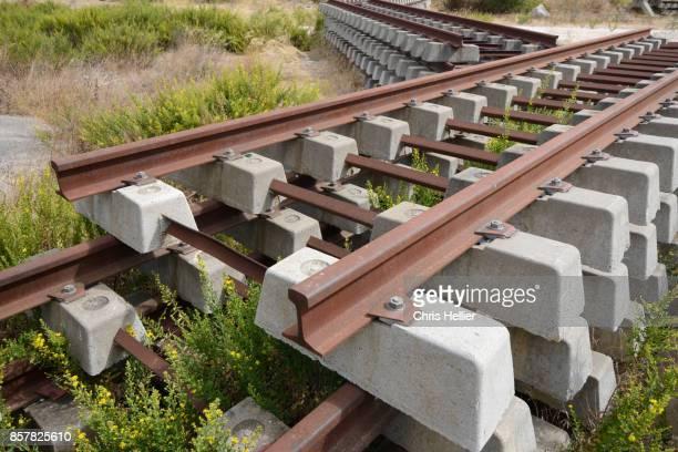 Piles of Concrete Railway Sleepers or Railroad Ties
