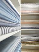 Piles of cotton fabric on shelfs