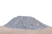 Piles of crushed stone isolate on white.
