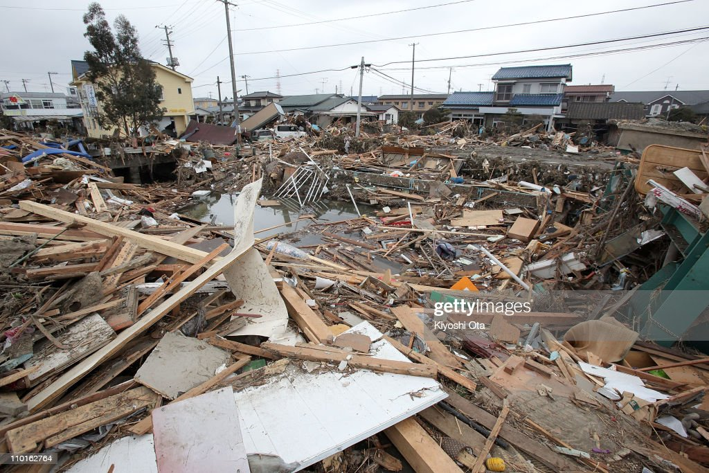 Piles of debris are seen in the area damaged by earthquake and tsunami after a 9.0 magnitude strong earthquake struck on March 11 off the coast of north-eastern Japan, on March 15, 2011 in Sendai, Japan. The quake struck offshore at 2:46pm local time, triggering a tsunami wave of up to 10 metres which engulfed large parts of north-eastern Japan. The death toll continues to rise with fears that the official death count could well reach up to 10,000 in 'the most tragic event in Japanese history since World War Two'.