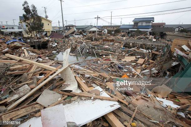 Piles of debris are seen in the area damaged by earthquake and tsunami after a 90 magnitude strong earthquake struck on March 11 off the coast of...