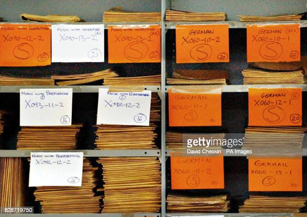 Piles of exam papers await marking in the offices of the Scottish Qualifications Authority in Dalkeith near Edinburgh Monday June 16 2003 Scottish...