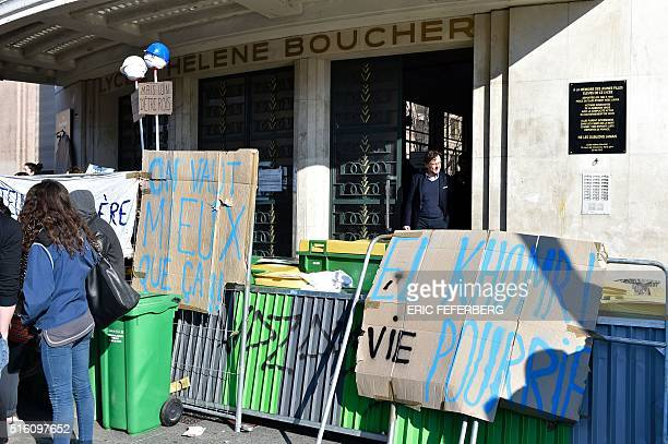 Piles of garbage and metal barriers set up by students block the entrance to the Helene Boucher high school on March 17 2016 in Paris Piles of...