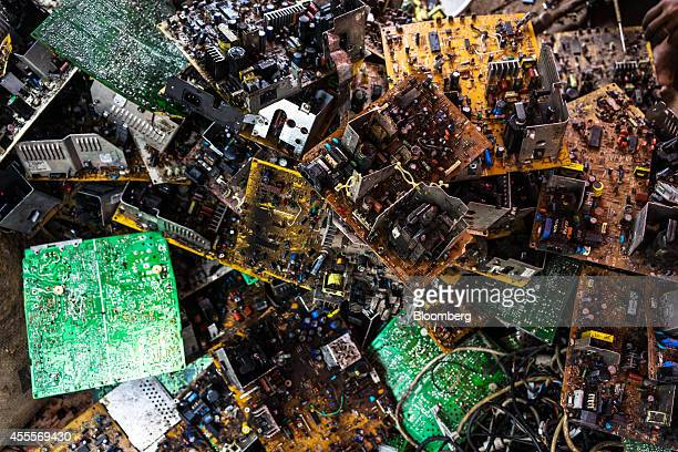 Piles of motherboards and circuit boards sit among electronic waste at a family compound of houses in Sangrampur village West Bengal India on Tuesday...