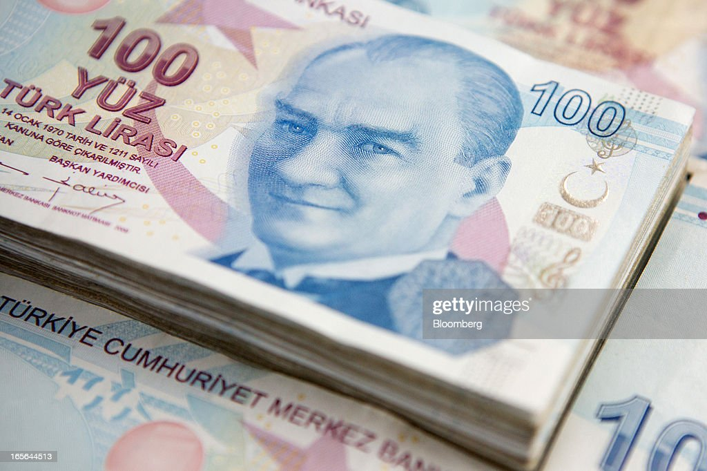 Piles of one hundred lira Turkish banknotes are seen in this arranged photograph in Istanbul, Turkey, on Thursday, April 4, 2013. Turkey's gross domestic product expanded 2.2 percent in 2012, down from 8.8 percent the previous year, according to data released by the statistics office in Ankara on April 1. Photographer: Kerem Uzel/Bloomberg via Getty Images