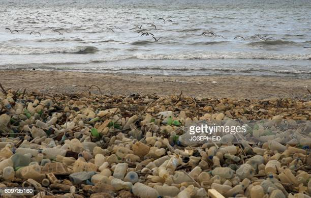 Piles of plastic waste are pictured on the seaside in the coastal town of Khalde south of the Lebanese capital Beirut on September 22 2016 / AFP /...