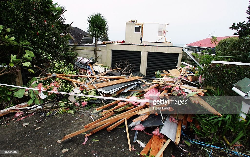 Piles of rubble lie at the front of a property on July 6 2007 in the seaside town of Oakura south west of New Plymouth New Zealand A state of...