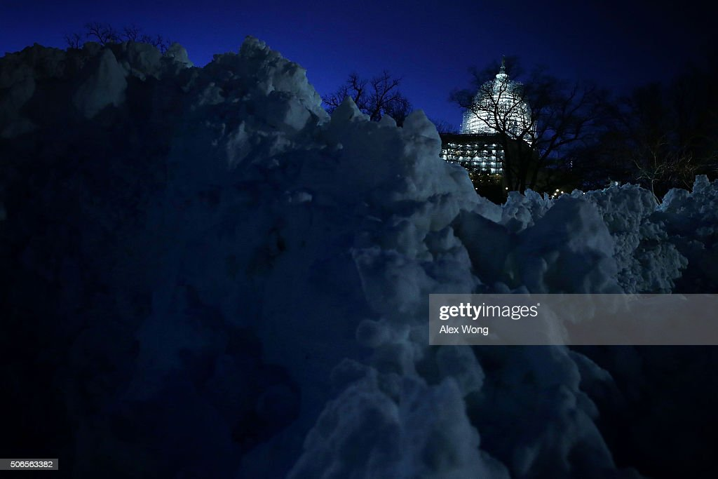 Piles of snow are seen in front of the US Capitol on January 24 2016 in Washington DC The blizzard that has brought massive snowfall and a standstill...