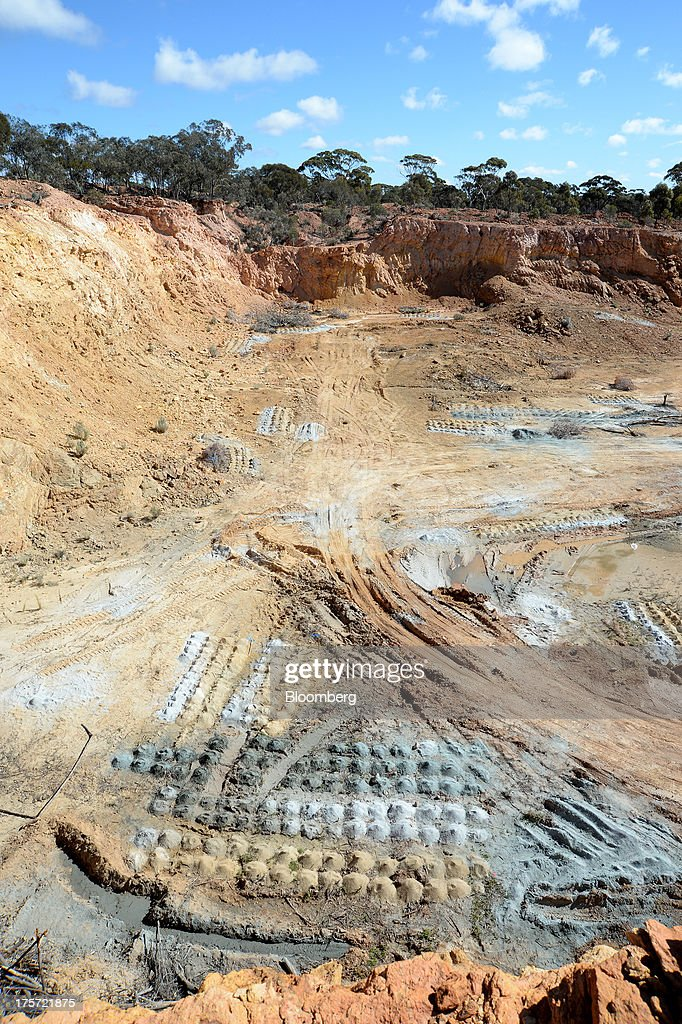 Piles of soil samples sit in rows at the Phoenix Gold Ltd. Castle Hill gold project in Kunanalling, northwest of Kalgoorlie, Australia, on Tuesday, Aug. 6, 2013. Gold prices will rebound as output remains little changed or declines this year with producers cutting spending and shuttering some costly operations, the World Gold Council said. Photographer: Carla Gottgens/Bloomberg via Getty Images