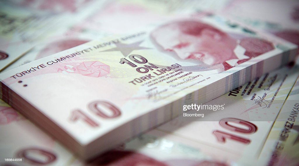 Piles of ten lira Turkish banknotes are seen in this arranged photograph in Istanbul, Turkey, on Thursday, April 4, 2013. Turkey's gross domestic product expanded 2.2 percent in 2012, down from 8.8 percent the previous year, according to data released by the statistics office in Ankara on April 1. Photographer: Kerem Uzel/Bloomberg via Getty Images