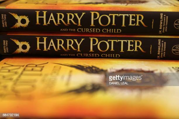 Piles of the new Harry Potter script book 'Harry Potter and the Cursed Child Parts One Two' are pictured inside Waterstones bookshop on Piccadilly in...