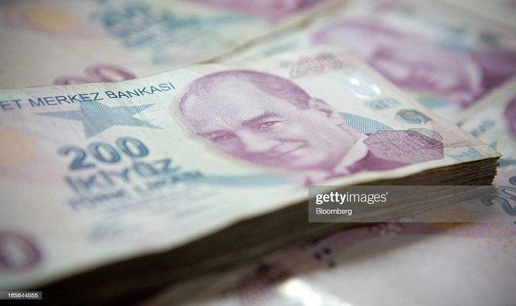 Piles of two hundred lira Turkish banknotes are seen in this arranged photograph in Istanbul, Turkey, on Thursday, April 4, 2013. Turkey's gross domestic product expanded 2.2 percent in 2012, down from 8.8 percent the previous year, according to data released by the statistics office in Ankara on April 1. Photographer: Kerem Uzel/Bloomberg via Getty Images