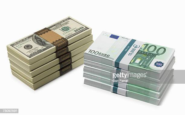 Piles of US Dollars and Euro banknotes