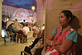 A pilgrim from Cambodia listening the concert in Krakow's Main Square due to the rain On Tuesday 26 July 2016 in Krakow Poland