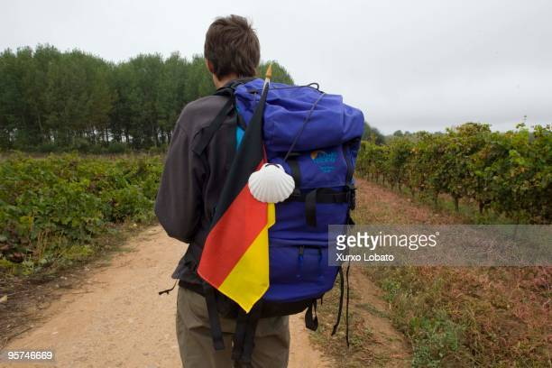 A pilgrim from Germany with the bag and the flag and shell in a Bierzo region in the way of saint James in Castilla and Leon 11th November 2009