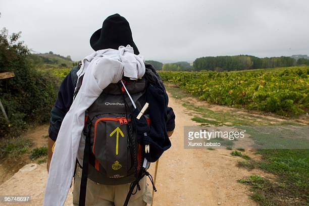 A pilgrim from Italy with the bag and the yellow arrow in a Bierzo region in the way of saint James in Castilla and Leon 11th November 2009