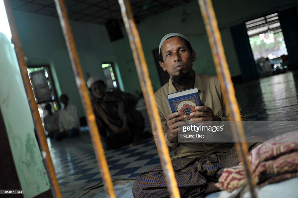 A pilgrim holding Koran while praying inside a mosque in Thae chaung refugee camp, outskirt of Sittwe on October 28, 2012 in Sittwe, Myanmar. Over twenty thousand people have been left displaced following violent clashes which has so far claimed a reported 80 lives. Clashes between Rakhine people, who make up the majority of the state's population, and Muslims from the state of Rohingya began in June.
