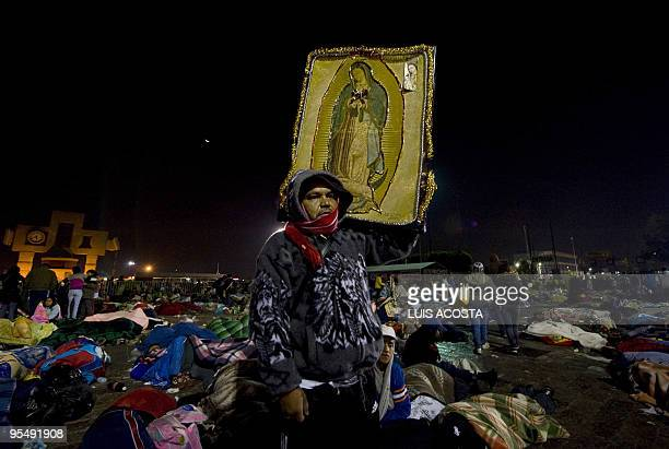 A pilgrim holds a holy image amidst others who sleep at the Basilica of the Virgin of Guadalupe Mexico's Patron Saint during the annual celebrations...