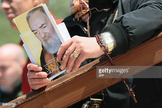 A pilgrim holds a missal during an open mass to mark the anniversary of Padre Pio's death and the display of his body for public viewing at San...