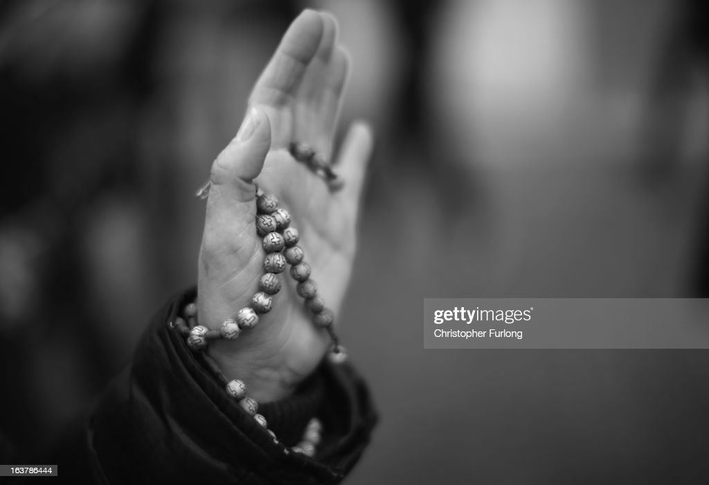 A pilgrim holds her rosary beads in St Peter's Square during a prayer meeting to honour Pope Francis on March 15, 2013 in Vatican City, Vatican. Daily life continues around the vatican as romans prepare for the inauguration mass of Pope Francis, the first ever Latin American Pontiff.
