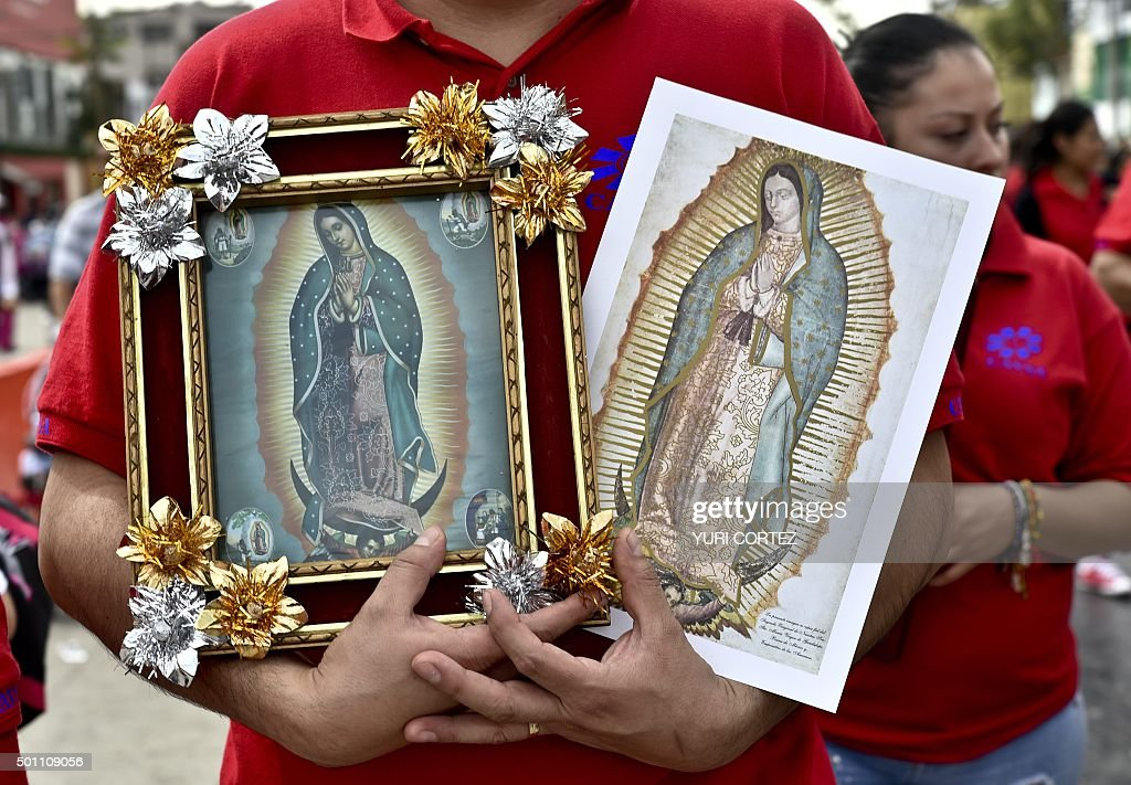 A pilgrim holds images of the Virgin of Guadalupe on his way to the Basilica of Guadalupe in Mexico City on December 12 2015 Pilgrims from all over...