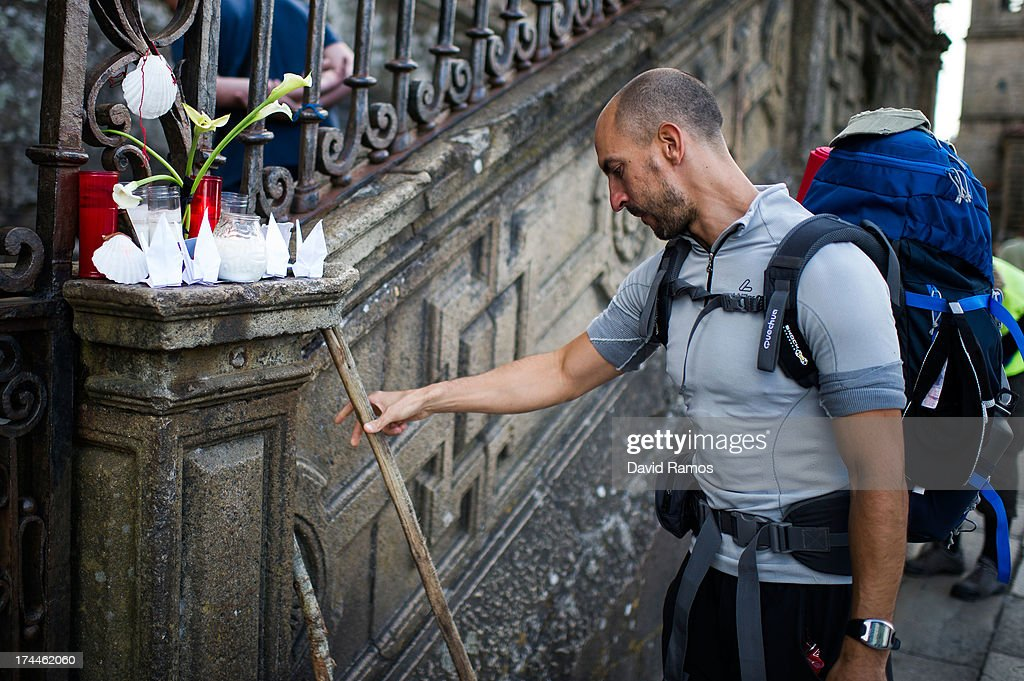 A pilgrim leaves his cane next to candles in memory of the train crash victims at the Cathedral of Santiago , on July 26, 2013 in Santiago de Compostela, Spain. The high speed train crashed after it derailed on a bend as it approached the north-western Spanish city of Santiago de Compostela at 8.40pm on July 24th. At least 78 people have died and a further 131 are reported injured. The crash occured on the eve of the Santiago de Compostela Festivities.