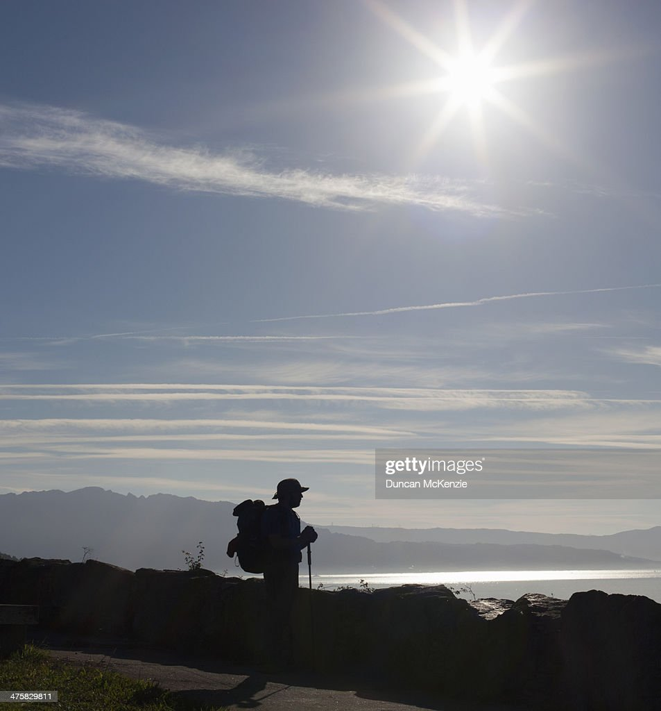 Pilgrim man walker silhouette beside ocean