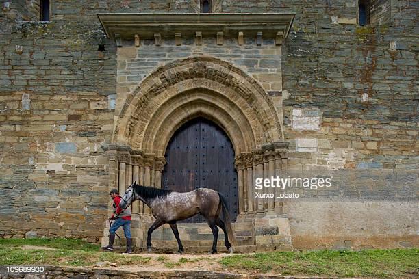 A pilgrim on horseback to the Puerta del Perdon of the church of Santiago in the town of Villafranca del Bierzo in the way of Saint James in Castlla...