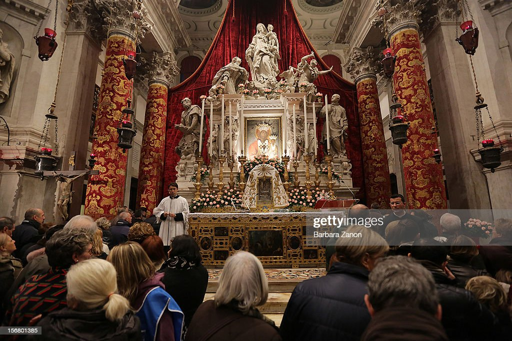Pilgrim pray inside the Church during the Santa Maria Della Salute celebrations on November 21, 2012 in Venice, Italy. During the annual Santa Maria Della Salute celebrations, Venetians make pilgrimage to the Church to give thanks to the Virgin Mary (Maria), who is believed to have brought an end to the plague which struck the city in 1629.