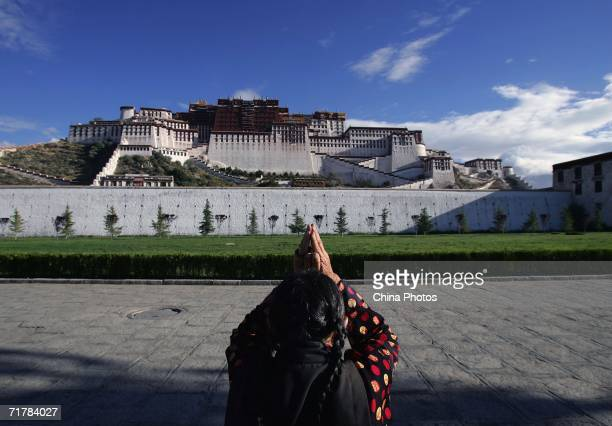 A pilgrim prays at the Potala Palace Plaza on August 30 2006 in Lhasa of Tibet Autonomous Region China Chinese tourists are flooding into Tibet this...