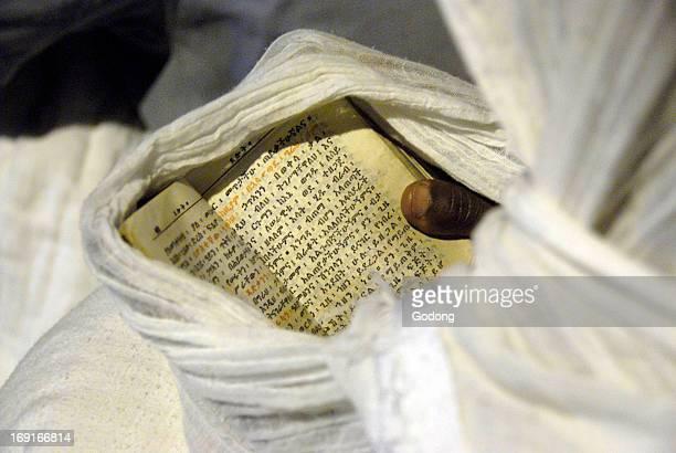 Pilgrim reading aprayer book in Lalibela