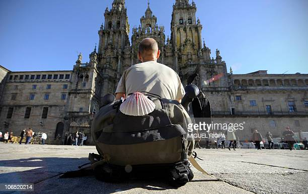 A pilgrim rests and looks at the Santiago de Compostela Cathedral on November 4 at the end of the Way of Saint James Pope Benedict XVI will visit...