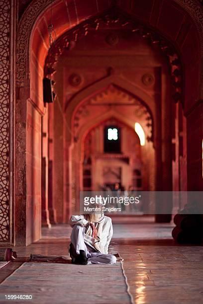 Pilgrim seated at Jama Masjid