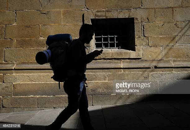 A pilgrim uses his smartphone next the Cathedral in Santiago de Compostela on August 24 after finishing the Way of Saint James In 2005 the trail drew...