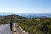 Pilgrim walking to Compostela on the french Way of St James (Camino de Santiago), near Ponferrada, Leon, Spain