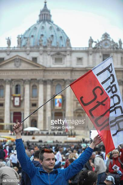 A pilgrim waves a Polish flag as he attends the canonisations of Popes John Paul II and John XXIII on April 27 2014 in Vatican City Vatican...