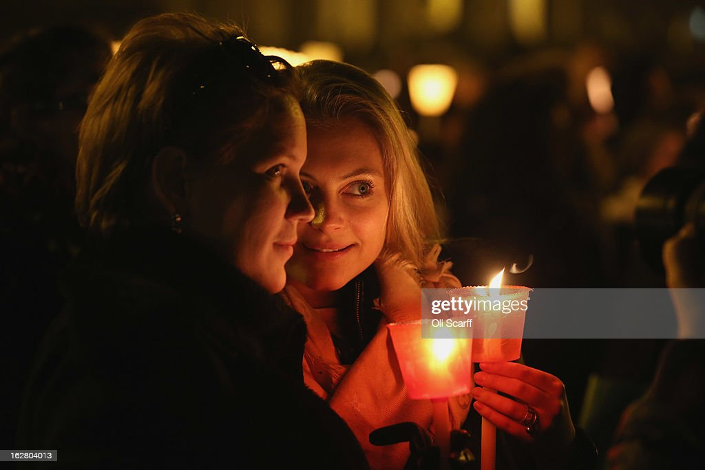 Pilgrims and clergy hold a candle-lit vigil in Saint Peter's Square, facing Pope Benedict XVI's private apartment, after his final weekly public audience on February 27, 2013 in Vatican City, Vatican. The Pontiff has attended his last weekly public audience before stepping down tomorrow. Pope Benedict XVI has been the leader of the Catholic Church for eight years and is the first Pope to retire since 1415. He cites ailing health as his reason for retirement and will spend the rest of his life in solitude away from public engagements.