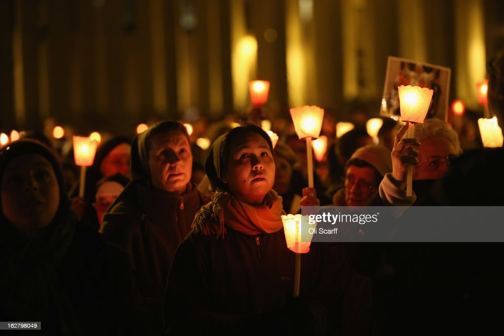 Pilgrims and clergy members hold a candle-lit vigil in Saint Peter's Square, facing Pope Benedict XVI's private apartment, after his final weekly public audience on February 27, 2013 in Vatican City, Vatican. The Pontiff has attended his last weekly public audience before stepping down tomorrow. Pope Benedict XVI has been the leader of the Catholic Church for eight years and is the first Pope to retire since 1415. He cites ailing health as his reason for retirement and will spend the rest of his life in solitude away from public engagements.