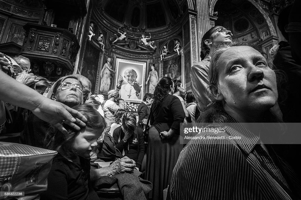 Pilgrims and faithful pray in the Church of SSpirito in Sassia dedicated to John Paul one day before the historical canonzation of Jonh Paul II and...