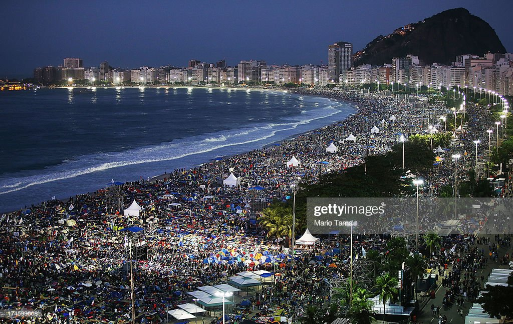 Pilgrims and residents camp out on Copacabana Beach before sunrise while awaiting Pope Francis' final Mass on his trip to Brazil on July 28, 2013 in Rio de Janeiro, Brazil. A reported crowd of three million faithful jammed the beach for a prayer vigil on the final night of World Youth Day last night. Francis' first international trip as Pope has drawn millions to see the first Pope to hail from Latin America. Brazil has the largest number of Catholics on Earth.