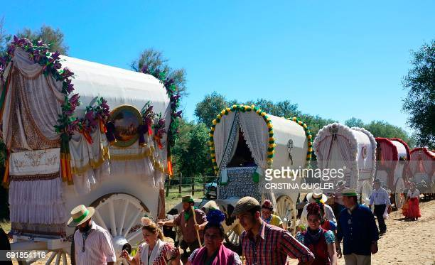 Pilgrims and their carriages go to cross the Ajoli bridge in the village of Rocio during the annual El Rocio pilgrimage on June 3 2017 in...