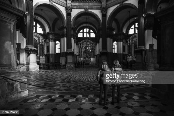 Pilgrims and tourists attend the opening Mass in the church of Santa Maria della Salute on the day before the traditional Festa della Salute on...